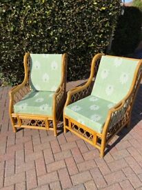 2 large cane chairs