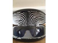 Beautiful genuine Roberto Cavalli sunglasses with original case. Lenses have a blue tint.