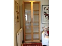 Quality Beech Style Glass fronted modern bookcase with adjustable shelves. Excellent condition.