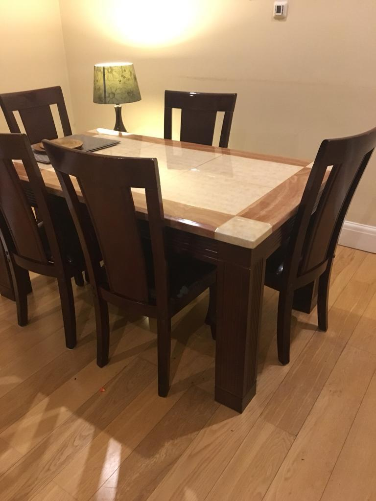 Marble top dinning table and 5 chairs