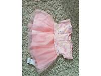 2 brand new dresses 6-9 months and 0-3