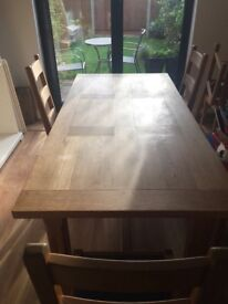 Real oak table and four chairs for sale.180 cm x 90cm wide.Extends to 190cm.Buyer to collect.