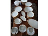 LIMOGES CHINA DINNER SERVICE. 61 PIECES. WHITE WITH GOLD TRIM