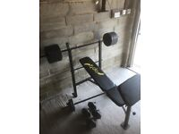 Weight bench and weights nearly new.