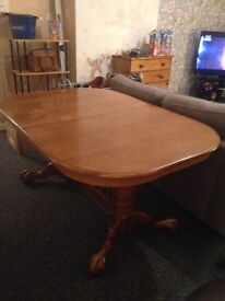 extending pine table with 2 inserts, has 2 captain chairs and 6 normal chairs