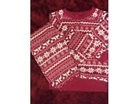 New. Super soft fleece pyjamas. Red with reindeer print. Size small 8-10. Drayton