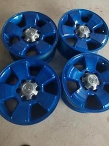 BRAND NEW NEVER MOUNTED TOYOTA TACOMA  FACTORY OEM  17  INCH ALLOY WHEEL SET OF 4..THE WHEELS ARE  POWDER COATED BLUE