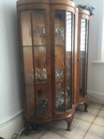 Glass display cabinet with walnut wood.