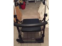 Maroon walking stroller with seat and basket