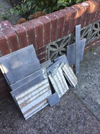 Free left over tiles and ceramic bath tub and toilet