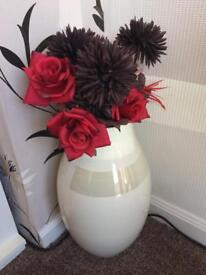 Cream vase with artificial flowers