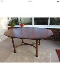 Ercol Saville extending dining room table, seats 6-8