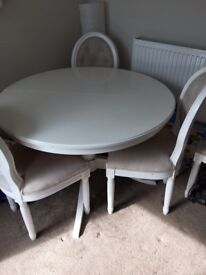 Extendable dining table and chairs.
