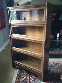 Oak glazed bookcase, in the Wernicke style