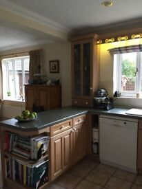 Fitted 'Hartland' Rose Limed Oak kitchen with 'green mosaic' worktops and integrated appliances