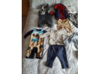 Items of mixed baby boy clothing
