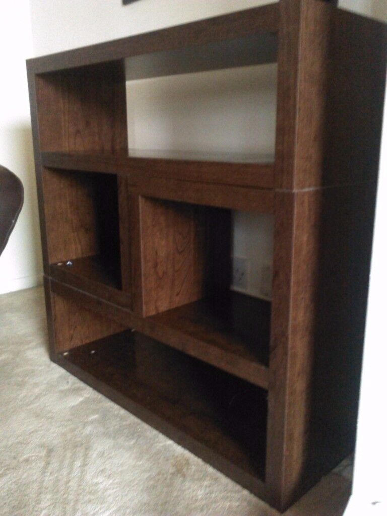 Chocolate brown wooden next bookcase