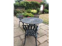 Wrought Iron table with 3 chairs, 4th chair available but needs repair
