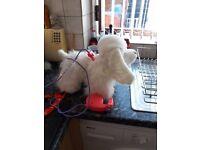 White interactive dog which walks