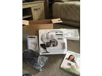 Beldray 12 Stitch Sewing Machine. Hardly used. Some accessories, carry bag and beginners book incl.