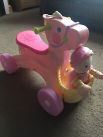 Fisher price pink ride on horse and doll