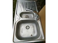 Kitchen sink and pipe fittings
