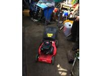 Champion self propelled petrol lawn mower