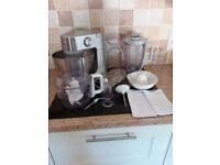 Stainless steel Kenwood chef complete with liquidiser and food processing attachment.