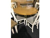 Lovely soid oak top round table and four beautiful chairs