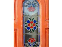 Hardwood front door with leaded, stained glass panel