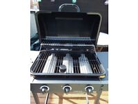 Gas barbecue and full gas bottle