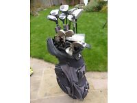 Golf Clubs - assortment of mens irons, wedges, drivers, a hybrid, two putters and bag