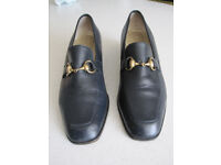 Ladies black leather court shoes by Russell and Bromley