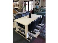 White table and six black leather chairs brand new