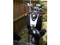 Direct bukes 49 cc black and white low miles