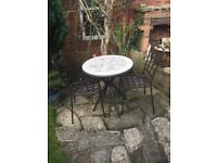 Mosaic ceramic topped steel framed circular Bistro table and two steel chairs.