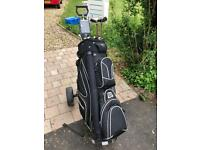 Ladies golf clubs, bag and trolley.