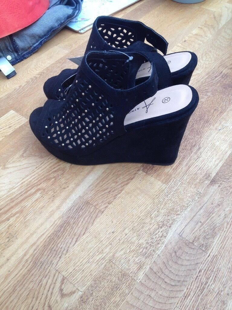 Brand new wedge shoes with tags size 4