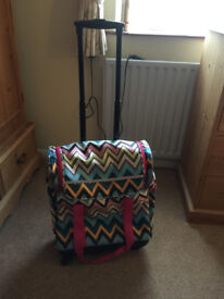 Multi coloured flight bag and small holdall
