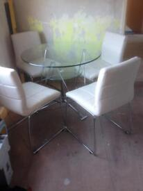 Glass table and cream chairs