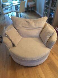 House of Fraser, cream rotating circular armchair, seats 1-2