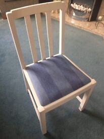 Two white and blue dining room chairs