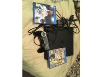 PlayStation 4 with 1 controller+ charger with fiffa 18 and Fiffa 17