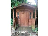 Wooden children's playhouse / shed