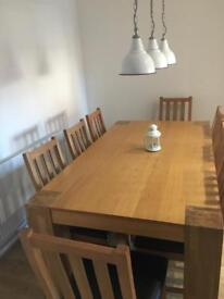 8 seater 6ft x 4ft solid wood table few minor scratches very good condition.