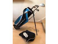 Set of Dunlop junior golf clubs (RH) including bag, shoulder strap and stand