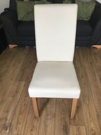 2 Cream Faux leather dining chairs in excellent condition.