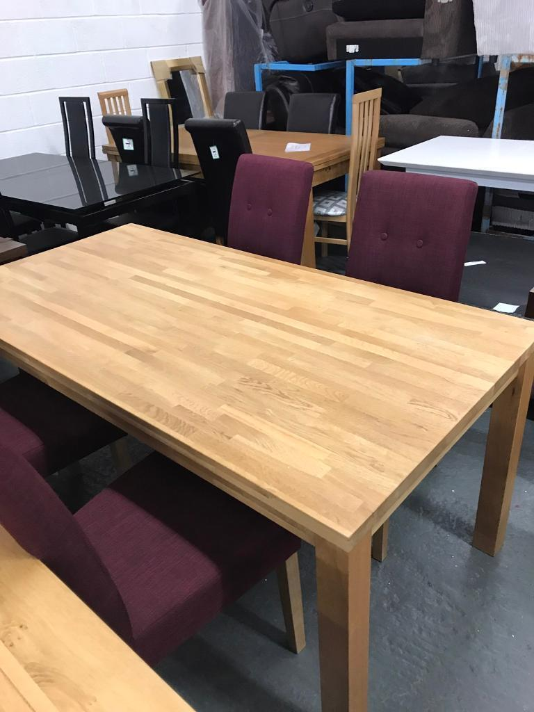 High retail oak dining table with 4 chairs