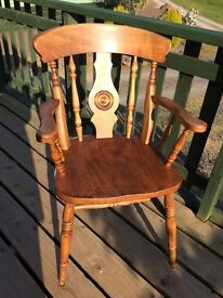 Solid wood carver chair in excellent condition.