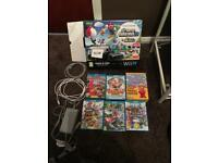 Black nintendo wii u 32gb with 6 games £120